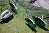 Green small boats on grass — Stock Photo