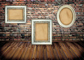 Frame on brick wall — Stock Photo