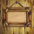 Stock Photo: Frame on bamboo wall