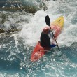 Stock Photo: Kayak on wawes of sea