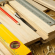 Stock Photo: Carpenters tools are on a wooden planks