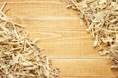 Wooden sawdust and shavings background with space for text — Stock Photo