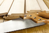 Carpenter's saw is on a woode planks — Foto Stock