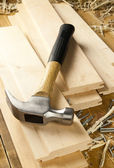 Hammer and nails are on a wooden planks — Stock Photo