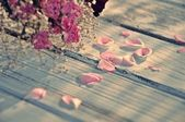Pink rose petals and dry bouquet — Stock Photo
