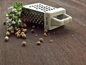White pepper with grater and thymus — Stock Photo