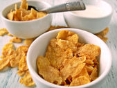 Corn flakes and milk in little cups — Stock Photo
