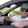 Sport car driver smiling — Stock Photo #10619722