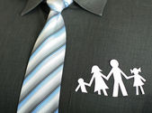 Paper family in a pocket — Stock Photo