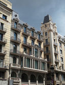 Building frontage under a storm sky, Barcelona center , Spain — Stock Photo