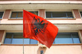 Albanian flag waving in Tirana — Stock Photo