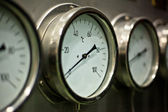 Industrial hydraulic pressure gauge in the factory — Stock Photo