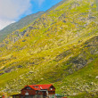 Stock Photo: House by lake in mountains, Carpathians, Romania, Europe