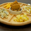 Various types of cheese on wooden plate — Stock Photo