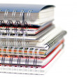Stock Photo: Multi colored Spiral notepads on white background background