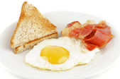 Bacon, eggs and toasts — Stock Photo