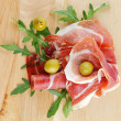 Royalty-Free Stock Photo: Slices of jamon and olives