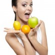Portrait of beautiful happy smiling girl with fruits lemon and green apple — Stock Photo #8686542
