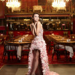 Beautiful sexy bride in unusual wedding dress in the restaurant — Stock Photo