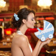 Beautiful bride in wedding dress in the restaurant with  perambulator — Stock Photo