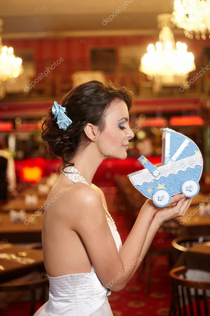 Beautiful bride in wedding dress in the restaurant with  perambulator  Stock Photo #8698793