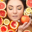 Close up portrait of smiling woman with many juicy citrus fruit lemon grape — Stock Photo #8774989