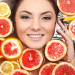 Close up portrait of smiling woman with many juicy citrus fruit lemon grape — Stock Photo #8774991