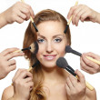many hands apply make up on woman makeup brushes — Stock Photo