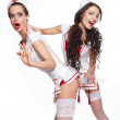 Two sexy beautiful  female brunette doctors in red lingerie white stocking - Stock Photo