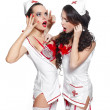 Two sexy beautiful female brunette doctors in red lingerie white stocking — Stock Photo #9085053