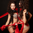 Royalty-Free Stock Photo: Fashion portrait of two sexy brunette girls in light lingerie with long cur