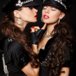 Two sexy beautiful brunette semi nude police women with long curly hair wi — Stock Photo #9085513