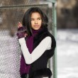 Beautiful american black female in the street outdoors winter — Stock Photo