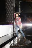 Beautiful burnette girl posing in the club — Stock Photo