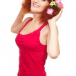 Portrait of beautiful smiling redhead ginger woman in red cloth with yellow pink colorful flowers in hair isolated on white with lemon in hands — Stock Photo #9653526