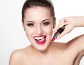 Closeup portrait of sexy smiling caucasian young woman model with glamour red lips,bright makeup, eye arrow makeup, purity complexion with red lipstick. Perfect clean skin.white teeth — Stock Photo