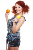 Portrait of beautiful smiling redhead ginger woman in summer dress isolated on white with orange and lemon — Stock Photo