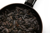 Black fried and salty sunflower seeds — Stock Photo