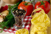 Ingredients for cooking pasta with tomatoes and herbs — Stock Photo