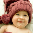 Little girl in the lilac hat and scarf — Stock Photo #8155434