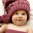 Little girl in the lilac hat and scarf — Stock Photo