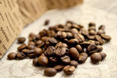 Coffee beans on linen tablecloths — Stock Photo
