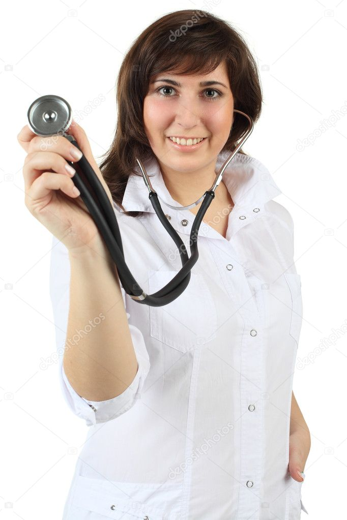 Doctor smiles and holding stethoscope to camera - isolated on white background  Stock Photo #8240403