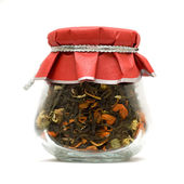 Herbal tea in glass jar isolated over white — Stock Photo