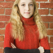 Stock Photo: Happiness teenager girl in red sweater