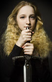 Fine art portrait of girl with sword — Stock Photo