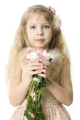 Beautiful child with spring flowers isolated on white — Stock Photo