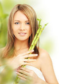 Spa woman with bamboo. Clear fresh skin — Stock Photo