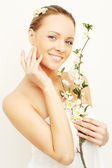Smiling woman with spring apple flowers — Stockfoto