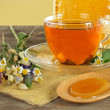 Tea, honey and flowers — Stock Photo